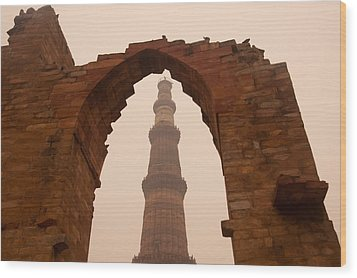 Cross Section Of The Qutub Minar Framed Within An Archway In Foggy Weather Wood Print