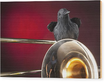 Crow And Trombone On Red Wood Print by M K  Miller