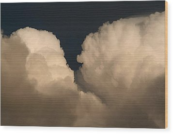 Cumulus Clashers Wood Print by Louise Mingua