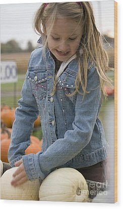 Cute Little Girl Picking A Pumpkin Wood Print by Christopher Purcell