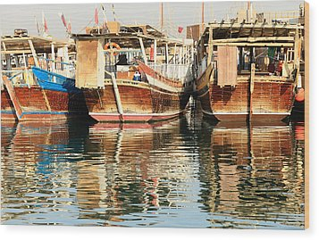 Dhow Reflections Wood Print by Paul Cowan