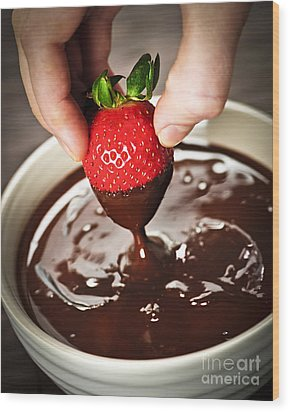 Dipping Strawberry In Chocolate Wood Print by Elena Elisseeva