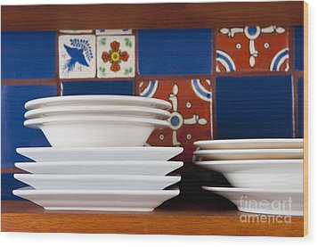Dishes In Front Of Colorful Tile Wood Print by Thom Gourley/Flatbread Images, LLC