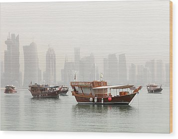 Doha In The Mist Wood Print by Paul Cowan
