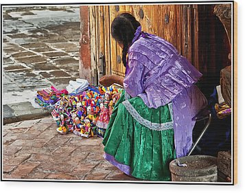 Dolls For Sale Wood Print by Javier Barras
