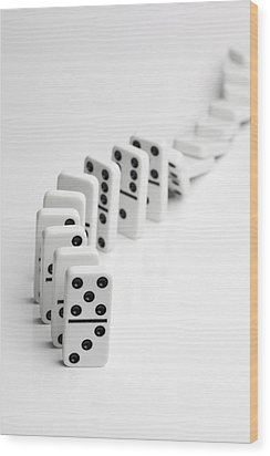 Dominoes Falling Over In A Chain Reaction Wood Print by Larry Washburn