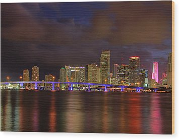 Downtown Miami At Night Wood Print by Claudia Domenig