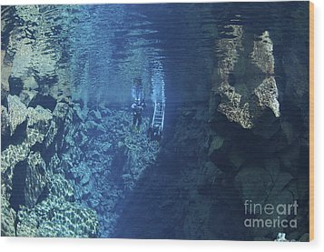 Dry Suit Divers Entering The Gin Clear Wood Print by Mathieu Meur