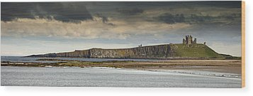 Dunstanburgh Castle On A Hill Under A Wood Print by John Short