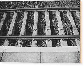 Edge Of Railway Station Platform And Track Northern Ireland Uk Wood Print by Joe Fox