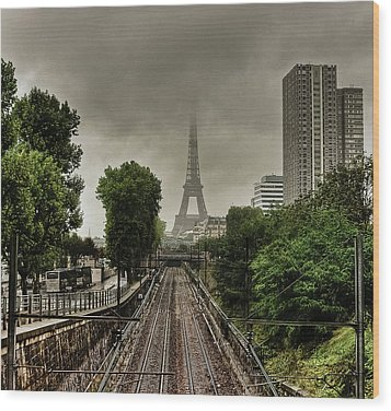 Eiffel Tower In Clouds Wood Print by Stéphanie Benjamin