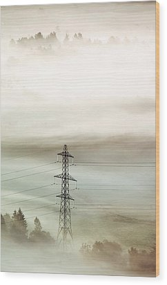 Electricity Pylon In Fog Wood Print by Duncan Shaw
