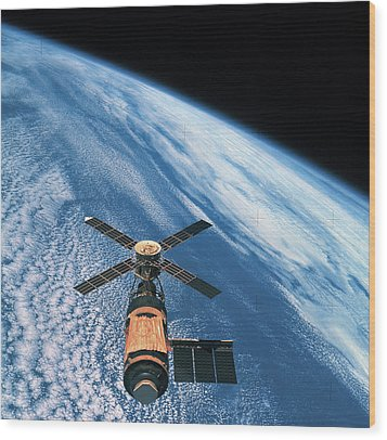 Elevated View Of A Satellite Orbiting In Space Wood Print by Stockbyte
