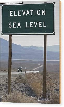 Elevation Sea Level Sign And Highway Wood Print by Rich Reid