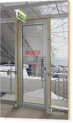 Emergency Exit At An Airport Wood Print by Jaak Nilson