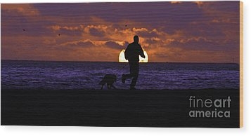 Evening Run On The Beach Wood Print by Clayton Bruster