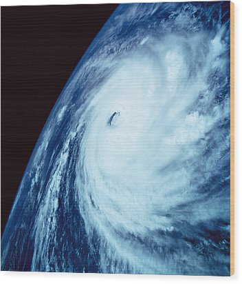 Eye Of A Storm Over Earth Viewed From Space Wood Print by Stockbyte