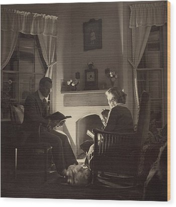 Family Reads At The Fireside. 1935 Wood Print by Everett