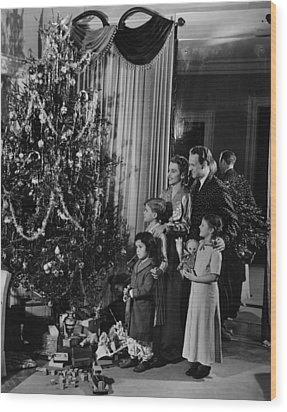 Family With Three Children (4-9) Standing At Christmas Tree, (b&w) Wood Print by George Marks