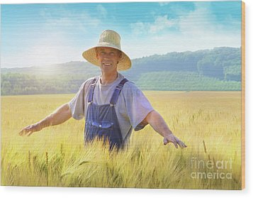 Farmer Checking Put His Crop Of Wheat Wood Print by Sandra Cunningham