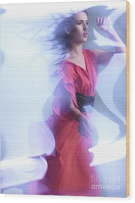 Fashion Photo Of A Woman In Shining Blue Settings Wearing A Red  Wood Print by Oleksiy Maksymenko