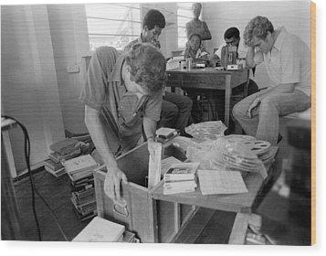 Fbi Agents In Jonestown, Going Wood Print by Everett