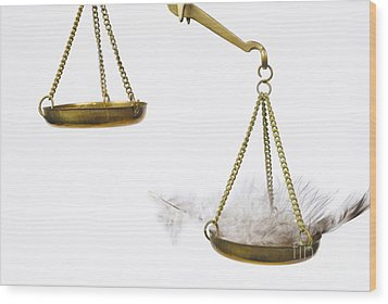 Feather On Weighing Scales Wood Print by Sami Sarkis