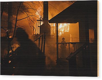 Firefighters Spray Down A Burning House Wood Print by Mark Thiessen