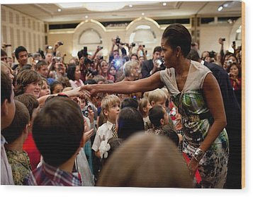 First Lady Michelle Obama Greets Wood Print by Everett