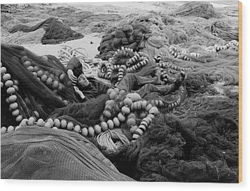 Wood Print featuring the photograph Fisherman Sleeping On A Huge Array Of Nets by Tom Wurl
