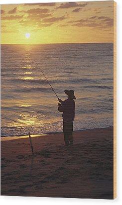 Fishing At Sunrise Wood Print by Raymond Gehman