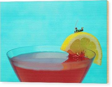 Fishing On A Piece Of Lemon Wood Print by Paul Ge