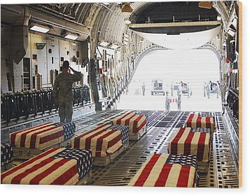 Flag Draped Coffins Of Five Us Soldiers Wood Print by Everett