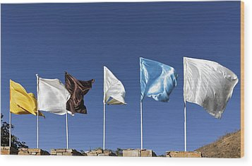 Flags Fluttering Against Blue Sky Wood Print by Kantilal Patel