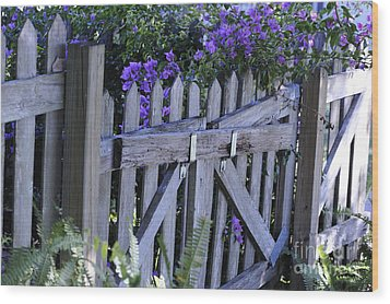 Flowers On A Fence Wood Print by Nancy Greenland