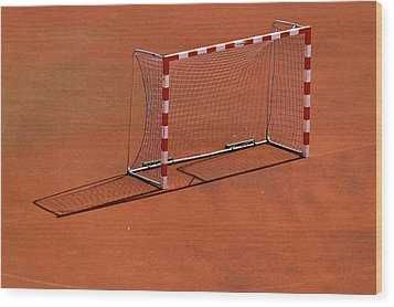 Football Net On Red Ground Wood Print by Daniel Kulinski