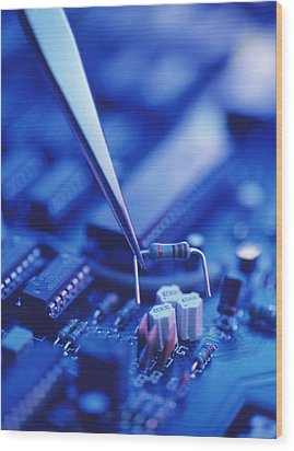Forceps Holding A Resistor Over A Circuit Board Wood Print by Chris Knapton