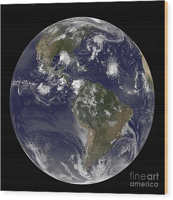 Full Earth Showing Tropical Storms Wood Print by Stocktrek Images