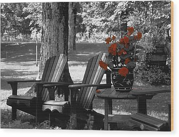 Garden Chairs With Red Flowers In A Pot Wood Print by David Chapman