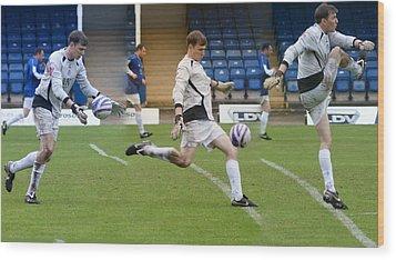 Goalkeeper Kicking Sequence Wood Print by David Birchall