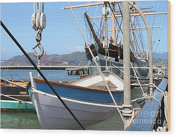 Golden Gate Bridge Through The Balclutha . A 1886 Square Rigged Cargo Ship At The Hyde Street Pier Wood Print by Wingsdomain Art and Photography