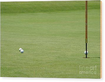 Golf Balls Near Flagstick Wood Print by Henrik Lehnerer