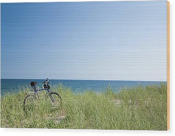 Grass Covering Bicycle Parked On Beach Dune. Wood Print by Alberto Coto