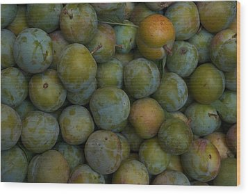 Green Plums Fill A Bin Outside A Local Wood Print by Heather Perry