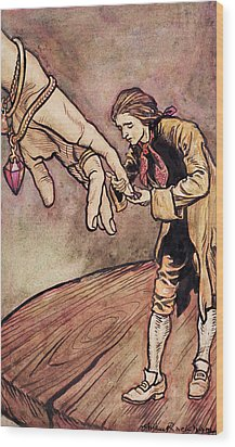 Gulliver In Brobdingnag Kissing The Hand Of The Queen Wood Print by Arthur Rackham