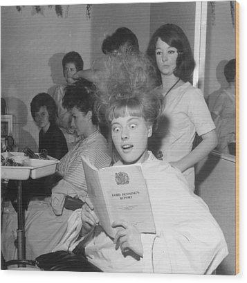 Hair-raising Report Wood Print by George Freston