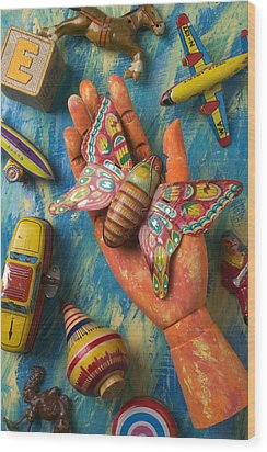 Hand Holding Butterfly Toy Wood Print by Garry Gay