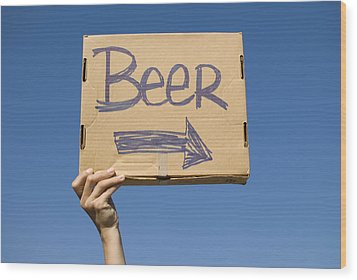 Hand Holding Up Makeshift 'beer' Sign Wood Print by Pete Starman