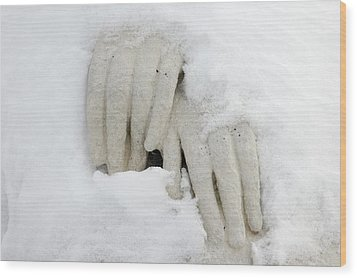 Hands Of A Statue Covered With Snow Wood Print by Matthias Hauser