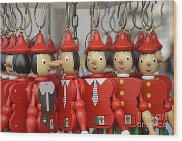 Hanging Pinocchios Puppets Wood Print by Sami Sarkis